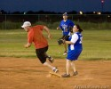 Derrick Wilbanks of the Daily Press team rounds second base as Veronica Rodriguez of the AGH Lifesavers looks for an incoming ball.