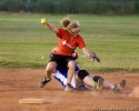 Suzi Miller of the Daily Press team is taken down by Irma Guillen of the AGH Lifesavers as she runs through second base.