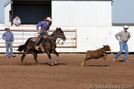 Ty Anderson of Artesia High School prepares to rope a calf during the demonstration Thursday.