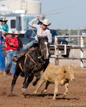 Shelby Kirkes of Carlsbad High School prepares to fire off her rope at a calf during the break away roping.