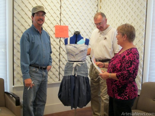 Noel Marquez, left, Ronnie Null, center, and Betty Jo Allen prepare to judge an entry in the Recycled Art Show today at the Artesia Historical Museum Art Annex Gallery. Entries are required to be composed of at least 75 percent recycled materials for the contest. Artists incorporated everything from old T-shirts and aluminum cans to the denim used in the dress pictured above. An open house reception is scheduled for 5-7 p.m. Friday, Feb. 18, at the Art Annex Gallery on Richardson Avenue. The show is sponsored by Artesia Clean & Beautiful. (Ashley Trujillo - Daily Press)