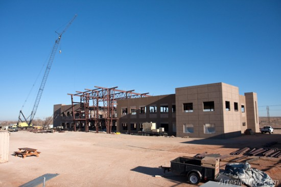 The new Mack Energy corporate office building being constructed north of U.S. 82 in Riverside is seen rising from the desert floor. Construction began on the building in May 2010 and is scheduled for completion in September. The 55,000 square foot building will host multiple=