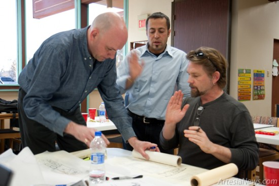 JMZ Architecture Design Architects, pictured from left, Chris Schmitt, Jose Zelaya and Michael Roehr work on a preliminary schematic plan for the new library at Artesia Public Library on Monday afternoon. (Tyler Green – Daily Press)