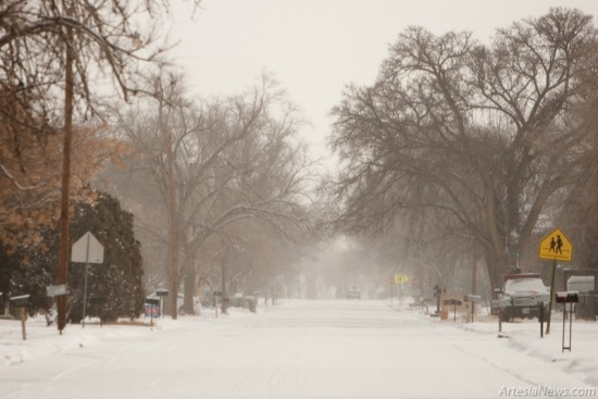 Snow-covered roads caused many motorists to drive with caution and avoid the roadways altogether.
