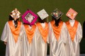 Graduates display thier decorative caps.