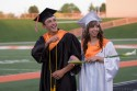 Henry Rodriguez and Brittany Scee, carrying a callalilly, walk past friends and family members on their way to their seats.
