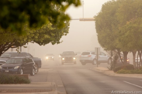 Blowing dust reduces visibility across Artesia Friday afternoon following a brief sprinkling of rain. Calls across the scanner concerning a fire west of town transformed into zero visibility warnings first at 26th and Main Streets then at 20th and Main Streets as the dust cloud traveled toward the east. (Tyler Green - Daily Press)