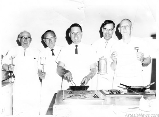 Members of First Presbyterian Church strap on their aprons and prepare to get to work during the 1969 May Day Breakfast. Pictured, from left, J.L. Briscoe, Hugh W. Kiddy, Donald Kiddy, Rev. George Wright and Sank Tunell.  The church will host the 100th breakfast from 6-9 a.m. Monday. (Courtesy photo)