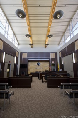 The Municipal Courtroom features a tall curved ceiling, a decorative marble wall and large windows to allow natural light.