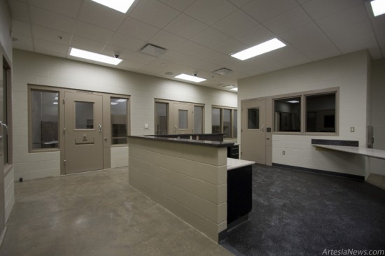 The detention area features multiple cells and a tunnel leading to the Municipal Courtroom.