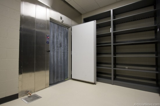 The main evidence storage room features several secure rooms for fire arms and narcotics along with a freezer for other evidence artifacts such as blood from a crime scene.