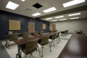 The briefing room can be divided into two rooms to accommodate multiple departments.