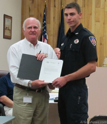 Mayor Phillip Burch, left, honors Firefighter/EMT Toby Bratcher, right, for helping a severely-injured woman who was struck by a car. (Ashley Trujillo – Daily Press)