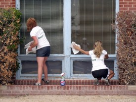 Scholars clean windows.