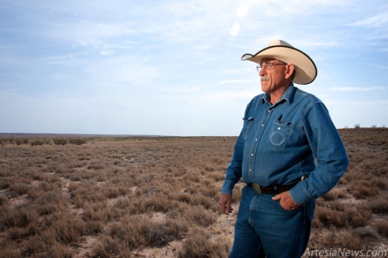 Eddy County Commissioner and rancher Lewis Derrick surveys the dry grazing grounds of Turkey Track Ranch 12 miles east of Artesia. Historic drought conditions have hit farmers and ranchers hard across southeast New Mexico and parts of Texas. (Tyler Green – Daily Press)
