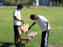 Jesus Lares, left, and Albert Scott paint a bench.