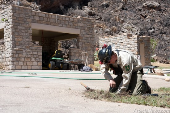 Sitting Bull Falls Site Manager Dennis Brockman replaces a damaged sprinkler head at the recreation area. (Tyler Green – Daily Press)