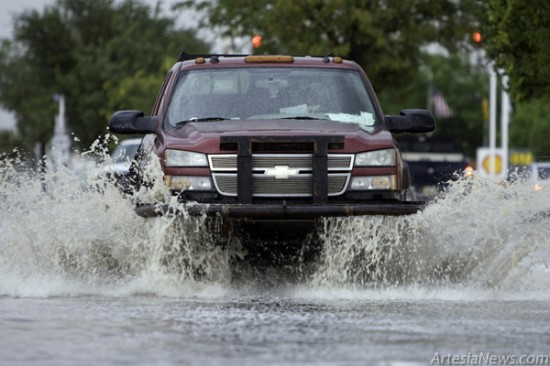A truck drives through a flooded intersection at First and Main streets. Artesia received .26 inches of rain yesterday in a matter of minutes flooding city streets. (Tyler Green – Daily Press)