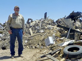 Raymond Jones stands in front of what is left of his home, which was recently destroyed by fire. (Elizabeth Lewis – Daily Press)