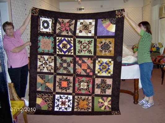 Vickie Cogar, left, and Ann Podany display a creation from the 2010 Artesia Quilters Guild exhibit at the Artesia Historical Museum and Art Center. (Courtesy photo)