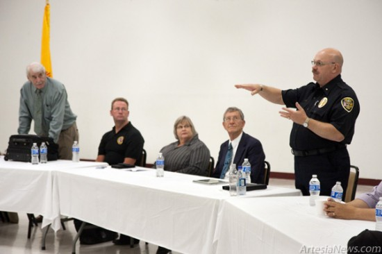 Artesia Police Department Chief Don Raley, right, answers a question from a seminar attendant about how the city and police department is working with the community to combat graffiti and clean up the streets. Also pictured, from left, are gang seminar panelists retired South Carolina Department of Corrections and Drug Enforcement Administration officer Robert Walker, San Bernardino Police Department Sergeant Dwight Waldo, Eddy County District Attorney Janetta Hicks and Eddy County Assistant District Attorney Les Williams. (Tyler Green – Daily Press)