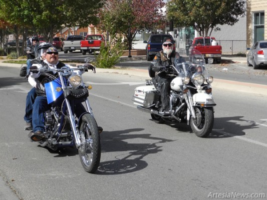 The Winged Riders held their 11th Annual Toy Run and Food and Coat Drive Saturday. The Riders gathered at Kmart with their bounty of toys, nonperishable food items, coats and blankets before parading east on Main Street to Second Street and gathering on Quay Avenue to collect the items. The toys, food and clothing were carried down Main Street. (Brienne Green - Daily Press)