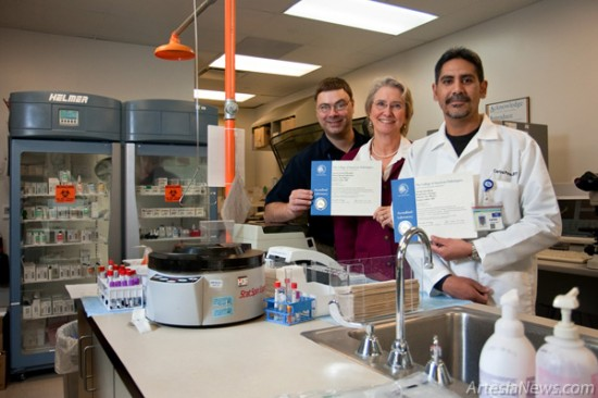 From left, Peter Grimm, MT (ASCP), Beth Mursch, MBA, MT (ASCP) SH, and Carlos Ponce, RRT, RCP, display the Artesia General Hospital laboratory's CAP certificates. (Tyler Green – Daily Press)
