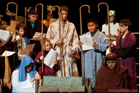 shepherds and angels gather onstage during the artesia high school drama clubs presentation of the