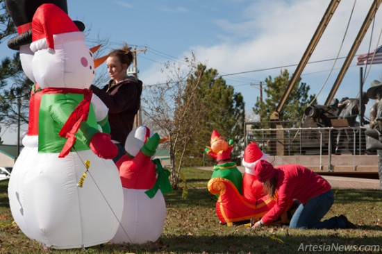 Kelly Klein, left, and Rebecca Prendergast set up holiday decorations at The Derrick Floor on Main Street this morning in preparation for this evening's Light Up Artesia event. Light Up Artesia will kick off with the arrival of Santa Claus, who will parade east on Main Street from Terry's Electronics to the Ocotillo Performing Arts Center at 5:45 p.m. Children will be able to deliver their Christmas wish lists to Santa at the Ocotillo, and adults will be able to shop till they drop as numerous local merchants remain open until 9 p.m. In addition, several vendors will set up in the downtown area and other retail locations around town, offering goodies, drinks and specialty items. (Tyler Green – Daily Press)