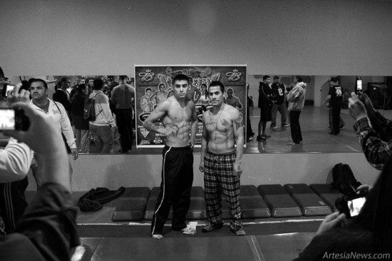 Professional fighters Andres Quintana of Roswell (left) and Xavier Estrada of Lubbock, Texas pose for pictures after weighing in. Quintana and Estrada fought in the 145-pound main event.