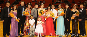 The 2011-12 Basketball Homecoming Court poses for a photo after being crowned Saturday at Bulldog Pit. They are, from left, Junior Attendant Sarah Solano and escort Drew Grantham; Senior Princess Kayleigh Helton and escort Skylor Morton; Queen Charis Kraft and escort Aaron Romo; Maid of Honor Jaci Faulkenberry and escort Seth Ashley; Senior Princess Jordan Herrera and escort Manny Favela; and Sophomore Attendant Kaity Butcher and escort Brock Bowman. Pictured at front are crown bearer and flower girl Arrian Rodriguez and Lashay Baumgardner.