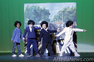 "Artesia Public Schools students replicate The Beatles' famous ""Abbey Road"" album cover during the National Dance Institute of New Mexico performance Friday at the Artesia High School Auditorium. Children from all five of Artesia's elementary schools and Grand Heights Early Childhood Center as well as a few teachers participated in the show, which featured a live band and numerous classic Beatles songs. This is the seventh year the NDI has presented a performance in Artesia. The annual event is made possible through a grant from the S.P. and Estelle Yates Family Foundation."