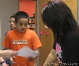 Central Elementary fourth-grader Johnny Perez receives a reading award at the school. The awards were recently distributed to Central students that have achieved their reading goals.