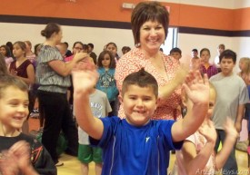 Yucca Elementary School second-grader Mateo Morillon, above, waves after returning to school following cancer treatment in Houston, Texas. Morillon was able to return to school after responding well to treatment and must only return to Houston for additional treatment once every three weeks. Below, Yucca students prepare for a spirit run with Morillon through the halls.