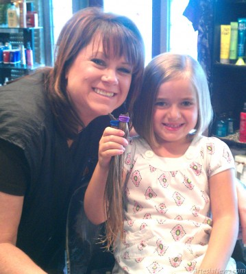 "Abbigail Heisler, 6, donated 11 inches of her hair to Locks of Love. ""Abbigail is always thinking of everyone else,"" said her mother. ""She asked if she could cut her hair to make a wig for someone."" Lori Terry at Chez Camille Salon cut Abbigail's hair for the donation.  Courtesy Photo"