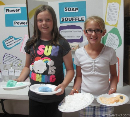 Lexi Carlo, left, and Hallie Vander Dussen test different brands of soap Tuesday to determine which float as part of their entry, Soap Souffle, into Yucca Elementary Schools fourth- and fifth-grade Science Fair.  Jackie Foster - Daily Press