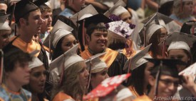 Artesia High School seniors listen as classmate Seth Ashley delivers a speech challenging them to retain their faith following graduation during Wednesday's Baccalaureate at the AHS Auditorium. Elizabeth Lewis - Daily Press