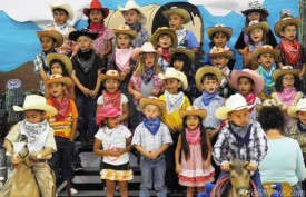 "Students in Mrs. Anderson, Mrs. Middlebrooks and Mrs. Harvey's kindergarten classes performed ""Cowboy Round-Up"" Wednesday in front of a packed house. Staci Guy - Daily Press"