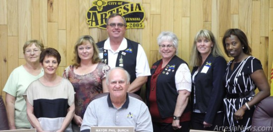 From left to right, Sharon Barker, Jay Barr of Hotel Artesia, Vicki and David Grousnick, organizers of Smokin' on the Pecos, Suzy McCaw of the Artesia Trailblazers, Tayni Crockett of First American Bank and State Farm Insurance Agent Clara Mauritsen were in attendance as Mayor Phillip Burch signed a proclamation Tuesday declaring June 29 and 30 as Smokin' on the Pecos State BBQ Championship Days. According to the proclamation, Smokin' on the Pecos will be a two-day event sanctioned by the Kansas City Barbeque Society and the Rocky Mountain Barbeque Association. Taking place on June 29- 30 at the Eddy County Fairgrounds, the annual event will include a craft show, a Cowboy Mounted Shooters' New Mexico Centennial Shootout, a roughstock challenge, mini-rodeo and open bull riding competition. The Grand Champion of Smokin' on the Pecos will receive an invitation to the American Royal Barbeque Cookoff in Kansas City. Elizabeth Lewis – Daily Press