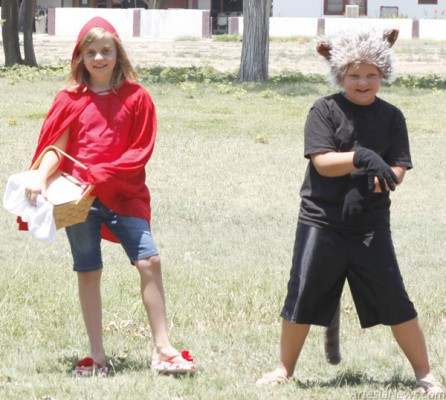 "Kassidy Branch, left, and Kaden Williams, two members of The Harvest Drama Kids, a local group of child actors, perform Wednesday in the park at Fourth Street and Richardson Avenue as part of the Artesia Community Theatre's Brown Bag Theatre series. The youth presented two plays, ""The Case of the Old Shoe Lady"" and ""A Crazy Story,"" both directed by Lori Jamieson. Elizabeth Lewis – Daily Press"