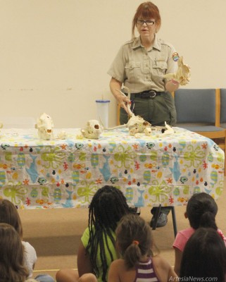 "Kathryn Law, educational coordinator for Living Desert Zoo and Gardens State Park, presents a program titled ""You Are What You Eat!"" to children involved in the Artesia Public Library's Summer Reading Program. Elizabeth Lewis – Daily Press"
