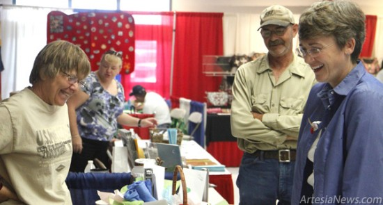 Heather Wilson converses with booth vendors Wednesday morning in the Exhibit Hall at the Eddy County Fairgrounds, campaigning her Republican candidacy for U.S. Senator. Wilson began her tour of southeastern New Mexico at the Eddy County Fair.  Elizabeth Lewis – Daily Press