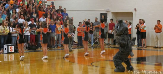 Artesia High School seniors join the senior cheerleaders and the Bulldog mascot in a cheer this morning at an AHSpep assembly designed to inform students of school traditions and what it means to be a Bulldog.  Rob Larson - Daily Press