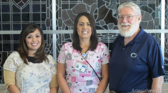 From left, Crystal Carreles and Sarah Jimenez pose with Artesia General Hospital Fund key overseer Joe Schiel. Not pictured is Jennifer Smoot. Rob Larson - Daily Press