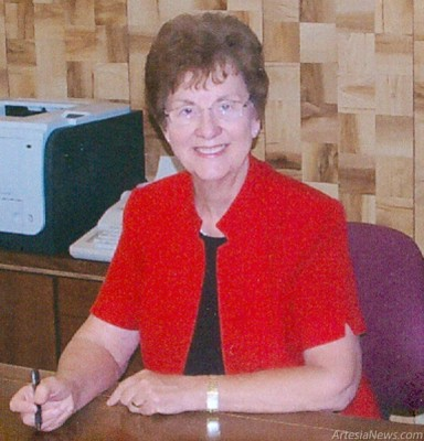 Ruby Parker, pictured here in her office, will celebrate 50 years in business. 