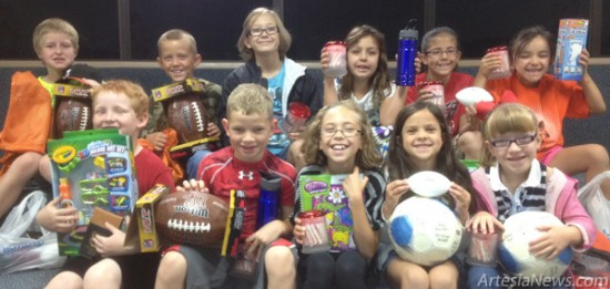 The top ticket sellers in Yeso Elementary School's annual enchilada dinner fundraiser pose with their prizes. For the second year in a row, Davis Eulenbach was the top fundraiser with 150 tickets sold. Second was Randall Hamilton with 95 tickets. Pictured are, back row from left, Hamilton, Caleb Laffery, Taylor Byers, Caty Moore, Riley Wortley, Ava Moore, front row from left, Trevor Brown, Eulenbach, Chloe Yates, Madison Livingston and Harlee Walker. The enchilada dinner will be held Friday, Sept. 21, in the Artesia (Park) Junior High School cafeteria preceding the Homecoming football game. The dinner is celebrating its 42nd anniversary, dating back to its beginnings at Abo Elementary School. Courtesy Photo