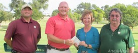 Shaun Weaver, second from left, of the North Eddy County United Way receives a donation from Gayle Burleson, New Mexico vice president of Concho Oil and Gas, last week at the Artesia Country Club as Juan Jimenez, far left, and Joe Smith, far right, of the country club look on. Concho donates all proceeds of the inaugural Concho Invitational Golf Tournament, held Sept. 13-15 at the ACC, to the United Way, an amount totaling $15,000-plus. Brienne Green - Daily Press
