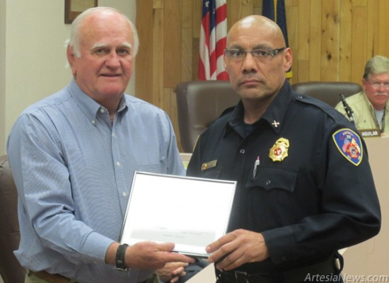 Mayor Phillip Burch presents Firefighter Eli Herrera of the Artesia Fire Department with a commendation from the City of Artesia for his 15 years of dedicated services with the AFD at Tuesday night's council meeting.