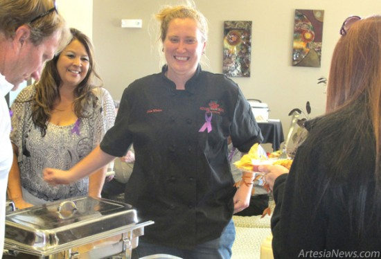 Chloe Winters, chef of Adobe Rose Restaurant, scheduled to open Nov. 16, offers samples of her cuisine to attendees of the Taste of the Pecos Valley to Fight Domestic Violence event Saturday at Hotel Artesia. The event, sponsored by Altrusa and Grammy's House,  featured tastings from several local eateries as well as live and silent auctions.  Brienne Green - Daily Press