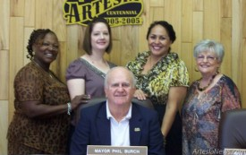 From left, Joyce Lloyd, Domestic Violence Offender Treatment Intervention (DVOTI) supervisor, DeAnne Luna, legal advocate, Celina Bryant, executive director of Grammy's House, and Sheila Simer, Grammy's House board member, join Mayor Phillip Burch as he signs a proclamation Tuesday at City Hall declaring October Domestic Violence Awareness Month in Artesia.